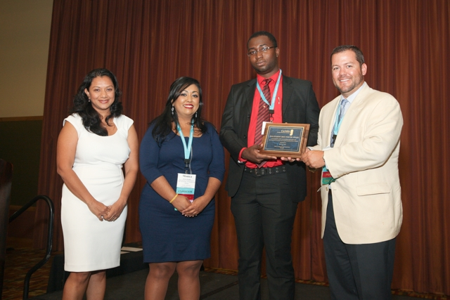 winner-of-the-2016-best-student-poster-award-mr-akil-de-leon-third-from-left-poses-with-the-committee-members-karlene-singh-monica-boodhan-and-jason-deal-from-left-to-right-during-the-awards-ce